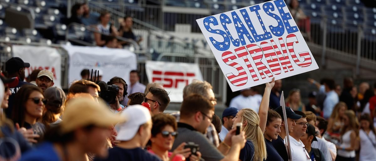 A Republican supporter holds up a sign supporting House Majority Whip Steve Scalise (R-LA) before the Democrats and Republicans face off in the annual Congressional Baseball Game at Nationals Park in Washington, June 15, 2017. REUTERS/Joshua Roberts