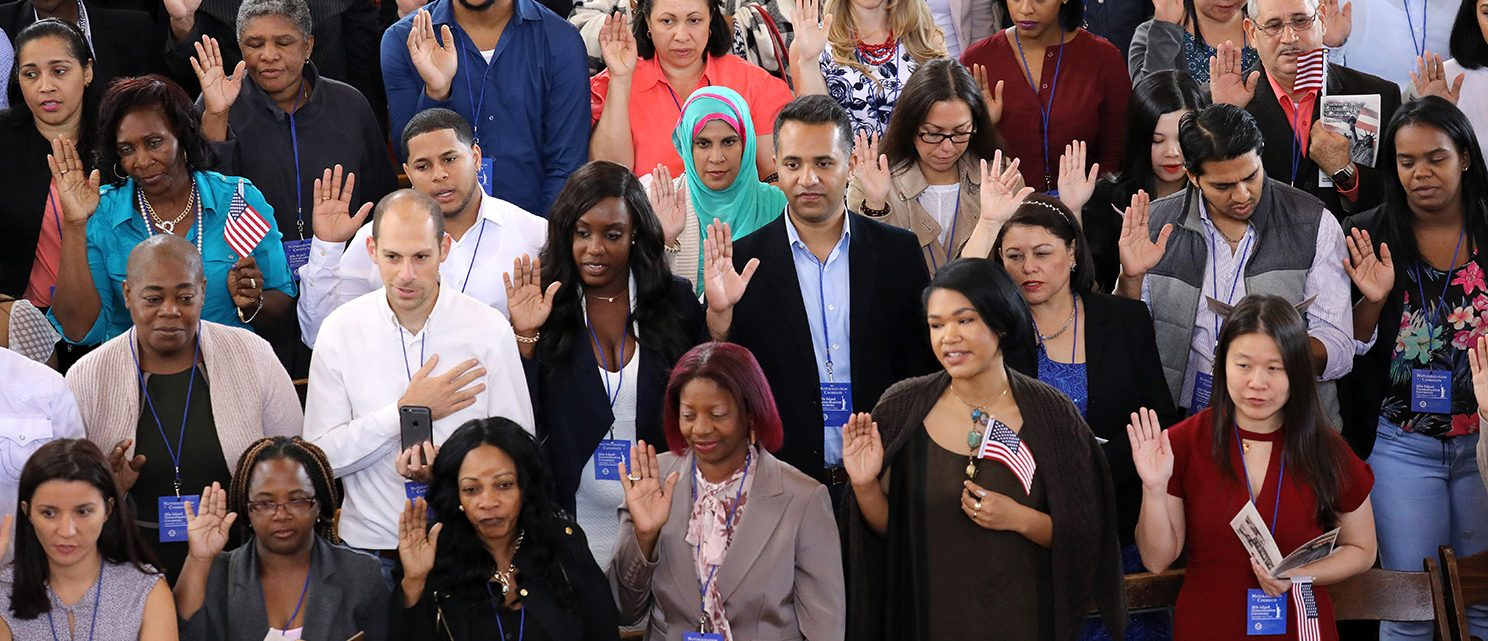 Immigrants take the oath of citizenship to the United States in the Great Hall of Ellis Island on September 16, 2016 in New York City. The ceremony marked Constitution and Citizenship Day, which is September 17. According to U.S. Citizenship and Immigration Services (USCIS), some 38,000 people nationwide are becoming American citizens in 240 ceremonies nationwide this week, the most of any period in 2016. (Photo by John Moore/Getty Images)