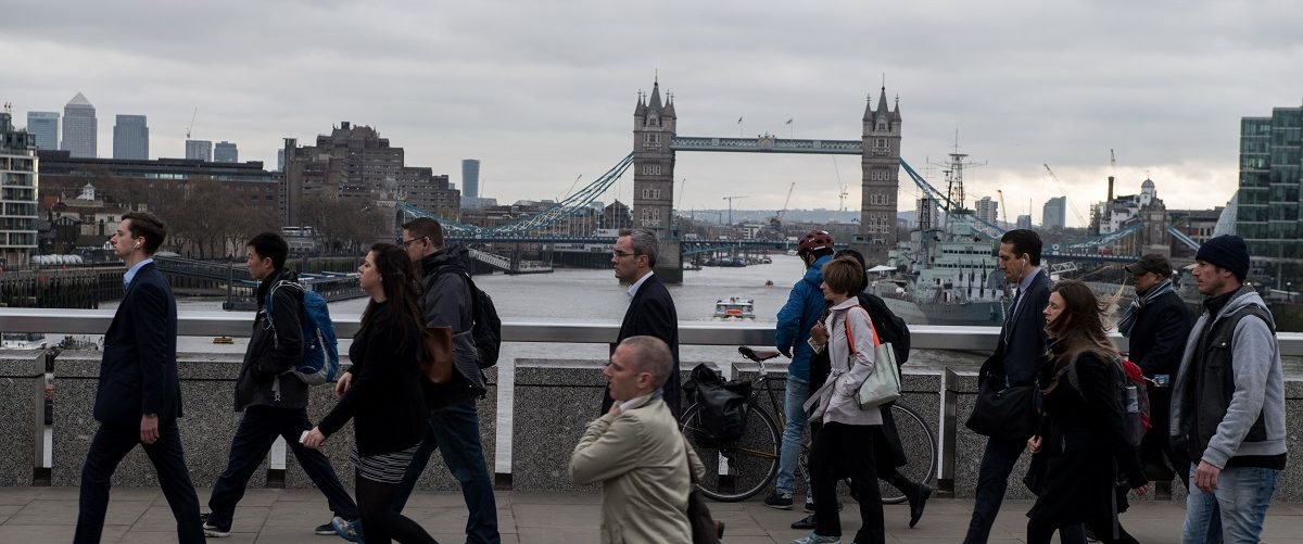 Commuters walk over London Bridge in central London on March 29, 2017. British Prime Minister Theresa May will formally launch Brexit today after signing the letter to begin the country's departure from the European Union. Chris J. Ratcliffe/AFP/Getty Images.