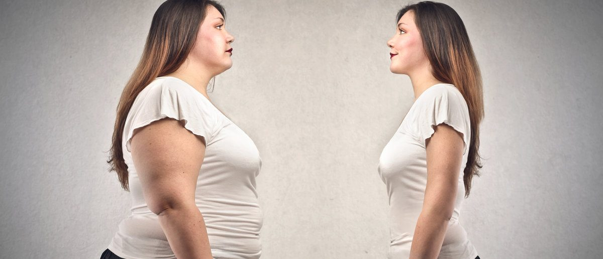 young fat woman and young woman lean (Shutterstock/Ollyy)
