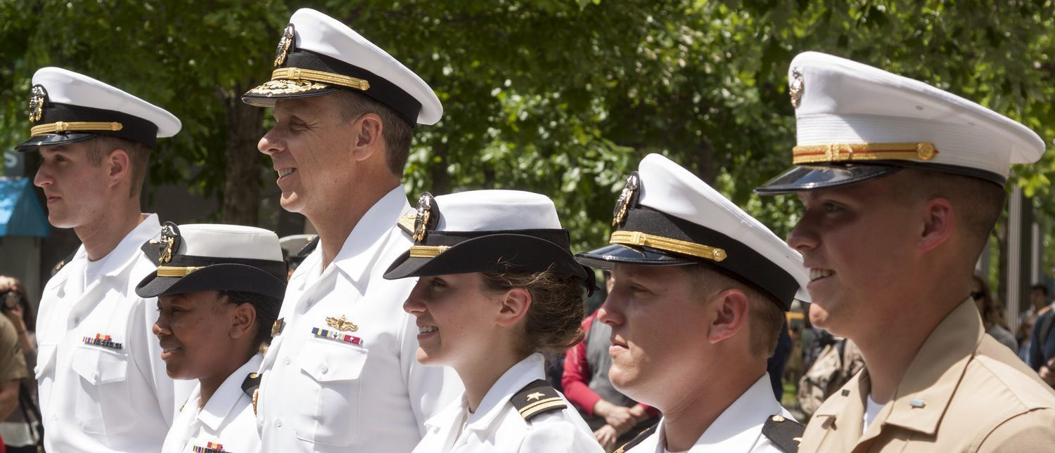 Participating US Navy and Marine Corps personnel stand at attention at the promotion ceremony at the National September 11 Memorial site during Fleet Week 2015. (Shutterstock/Glynnis Jones)