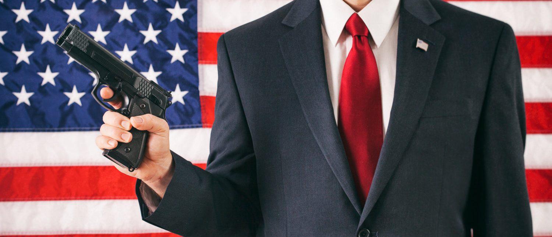 Politician: Man Holding Handgun Concept For 2nd Amendment Rights (Shutterstock/Sean Locke Photography)