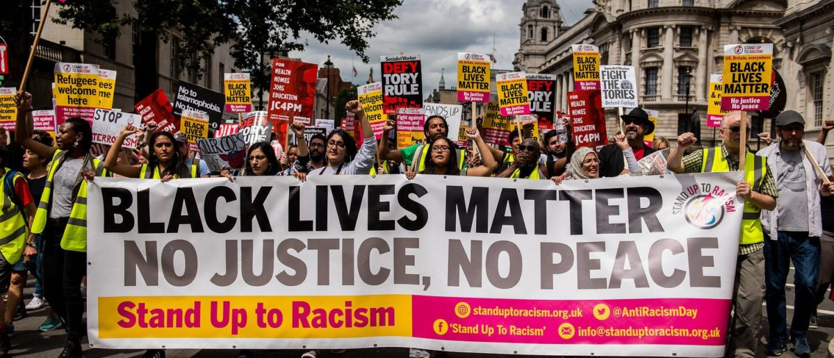 EDITORIAL - Black Lives Matter / Stand Up To Racism protest rally - Thousands attended the march through London, in protest of recent killings of black men by U.S. police. (Shutterstock/John Gomez)