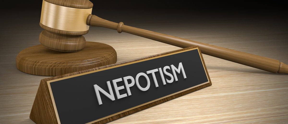 Laws against nepotism or favoritism of friends and relatives for jobs and advantages, 3D rendering  (Shutterstock/David Carillet)