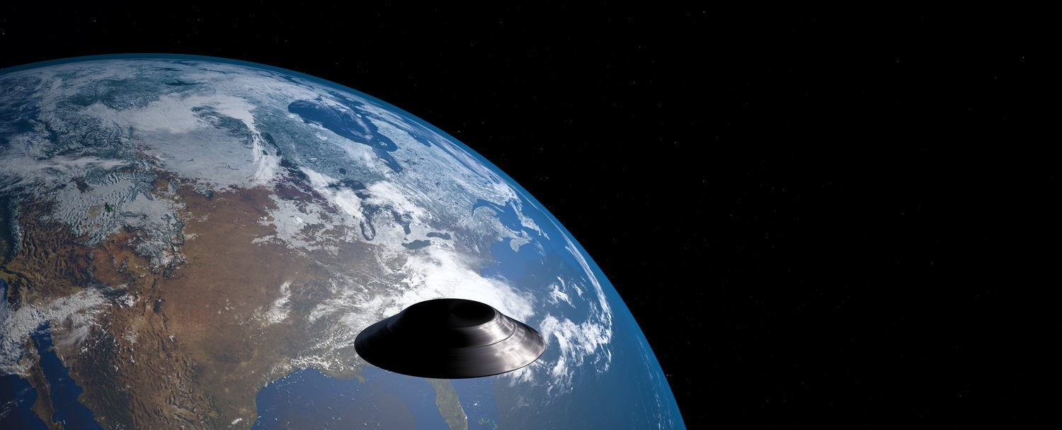 Extremely detailed and realistic high resolution 3D image of an ufo / flying saucer orbiting Earth. Shot from outer space. Elements of this image are furnished by NASA. (Shutterstock/Sasa Kadrijevic)