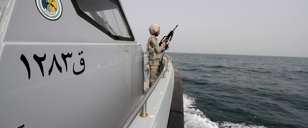 Saudi border guard watches as he stands in boat off coast of Red Sea on Saudi Arabia's maritime border with Yemen, near Jizan