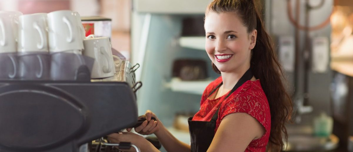 Smiling barista (Shutterstock/wavebreakmedia)