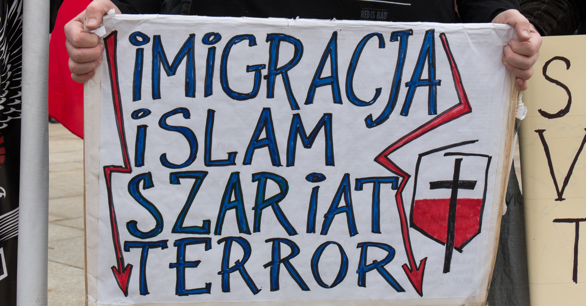 Shutterstock/ WARSAW, POLAND - FEBRUARY 06, 2016: Islam, sharia, terror, unidentified people during demonstration against refugees in Warsaw, Poland. Shutterstock/ Tomasz Bidermann
