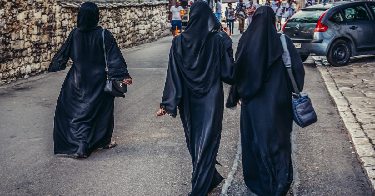 Shutterstock/ Mostar, Bosnia and Herzegovina - August 25, 2015. Three Muslim women walks on street in Mostar