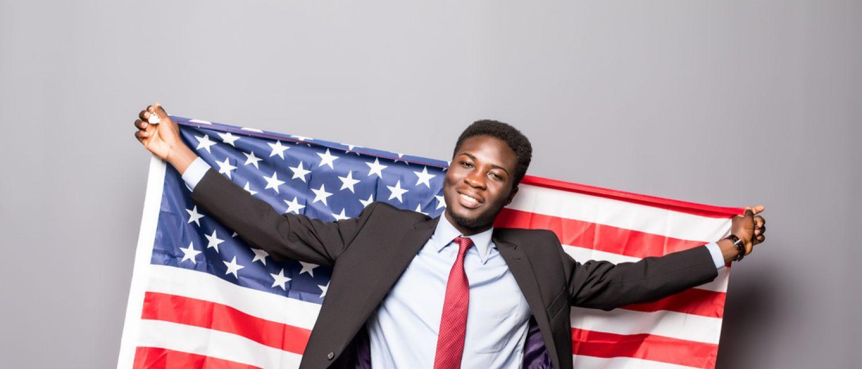 Black man with American flag (Shutterstock/F8 studio)