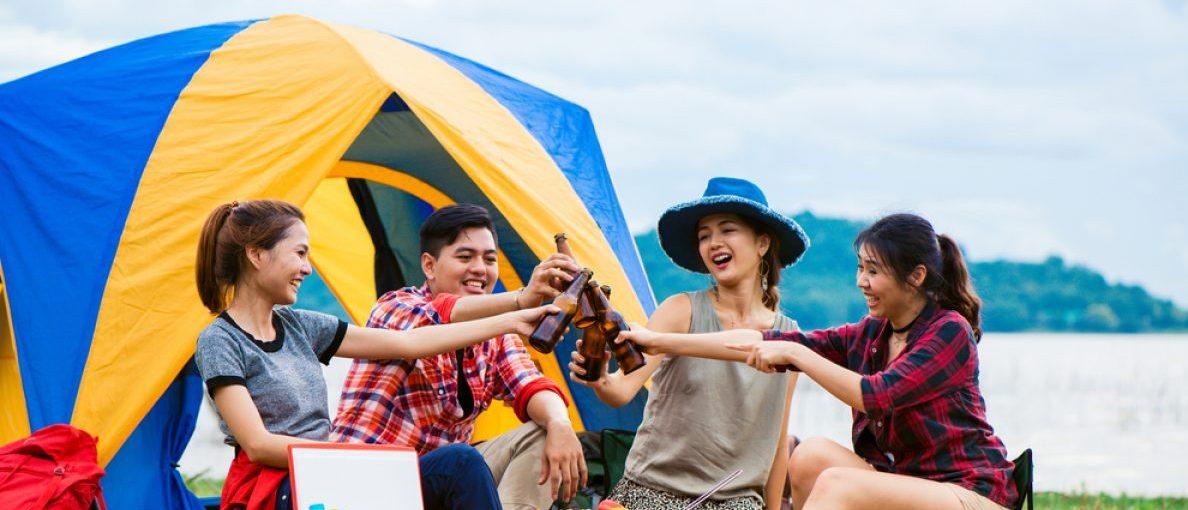 Adults having fun at a camp (Shutterstock/Tirachard Kumtanom)