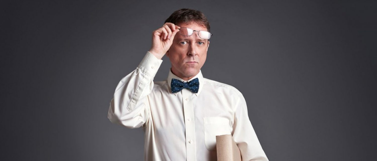 Professor raises his spectacles (Spectral-Design/Shutterstock)