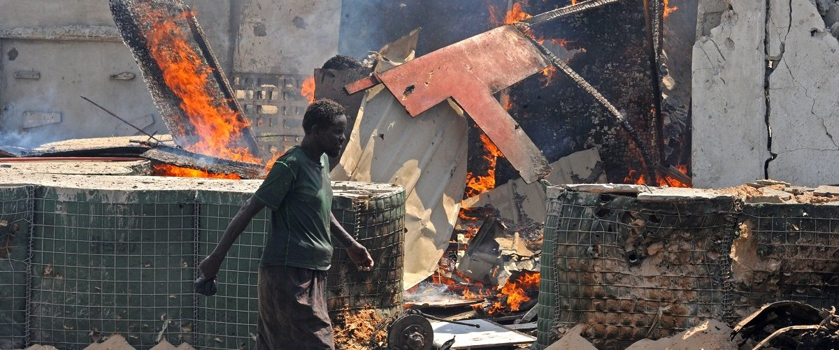 A man walks past the scene of a suicide attack in the Somali capital Mogadishu on July 31, 2016.