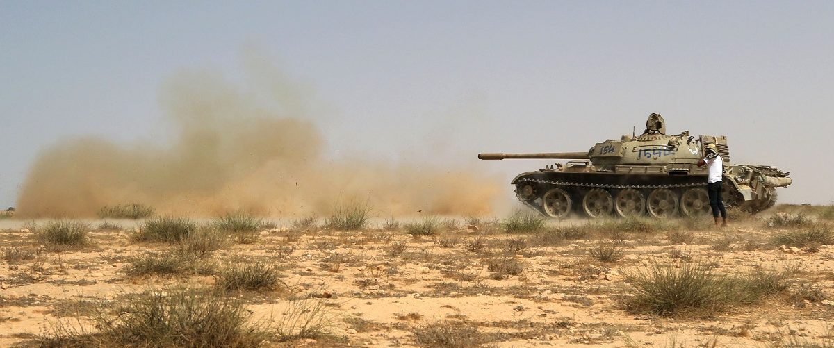 "Fighters from the pro-government forces loyal to Libya's Government of National Unity (GNA) use a tank on July 2, 2016 to hit Islamic State (IS) group targets in Sirte during an operation to recapture the coastal city from the jihadists. Fighters allied to the Government of National Accord took control of a residential area called the ""700 housing units"" near Ibn Sina hospital and the city's Ouagadougou conference centre, the GNA's forces said on social media. Mahmud Turkia/AFP/Getty Images."
