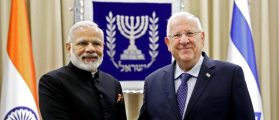 Israeli President Reuven Rivlin (R) shakes hands with Indian Prime Minister Narendra Modi at the president's official residence in Jerusalem July 5, 2017. REUTERS/Thomas Coex/Pool