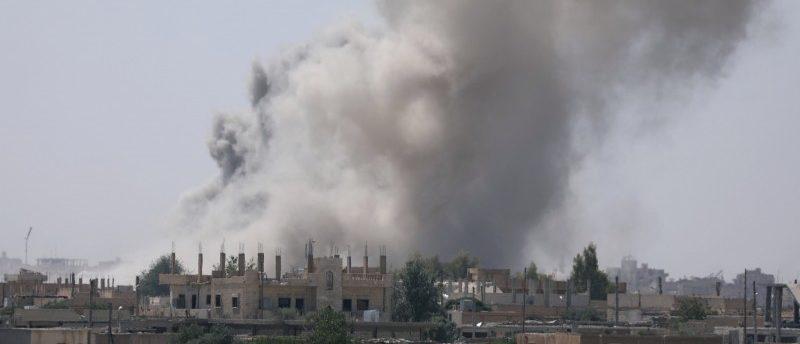 FILE PHOTO: Smoke rises from the al-Mishlab district at Raqqa's southeastern outskirts, Syria June 7, 2017. REUTERS/Rodi Said/File Photo