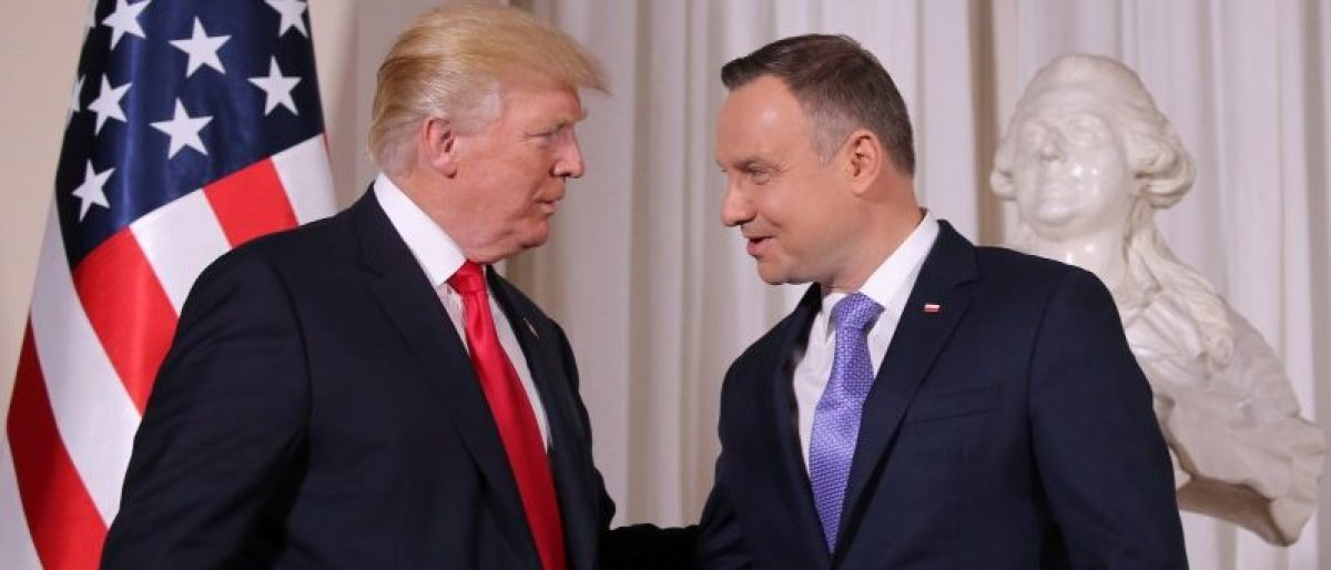 U.S. President Donald Trump is greeted by Polish President Andrzej Duda as he visits Poland during the Three Seas Initiative Summit in Warsaw, Poland July 6, 2017. REUTERS/Carlos Barria