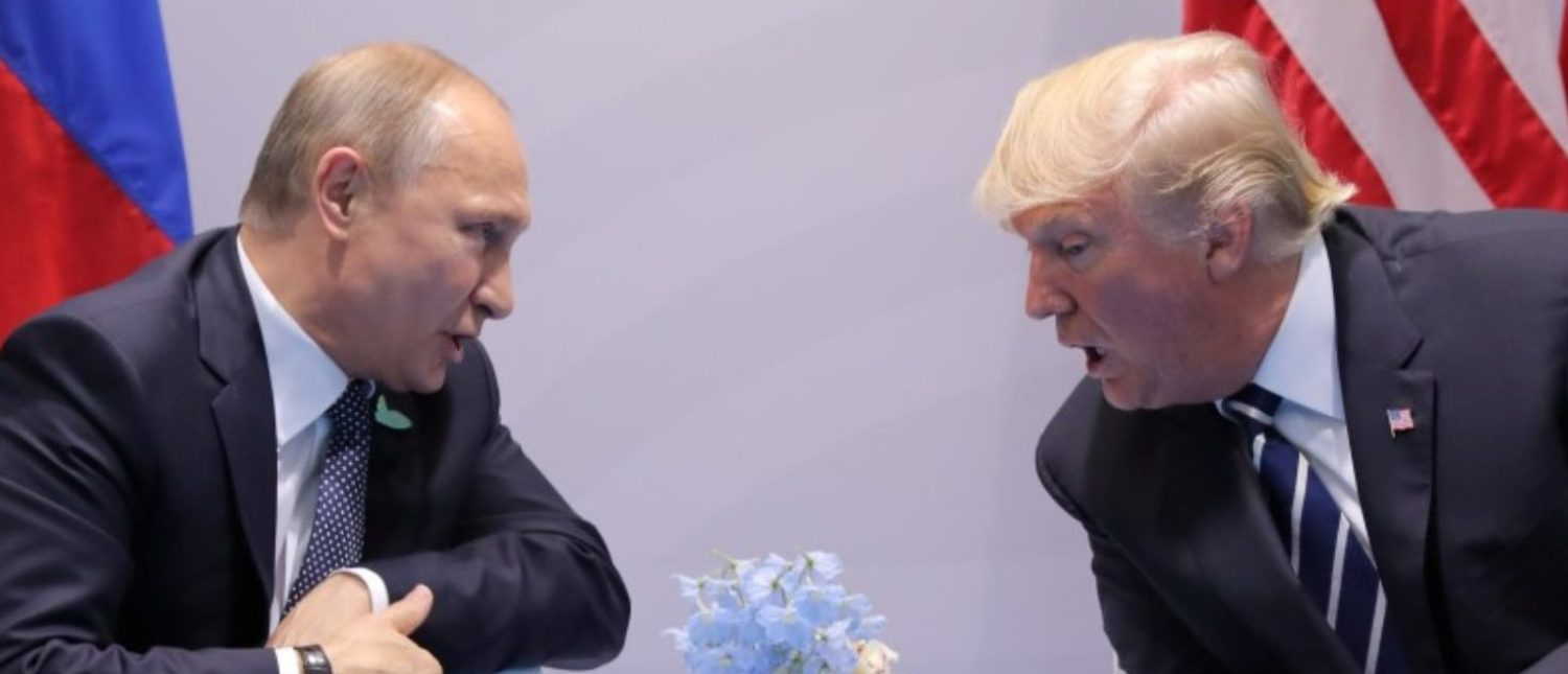 U.S. President Donald Trump speaks with Russian President Vladimir Putin during their bilateral meeting.
