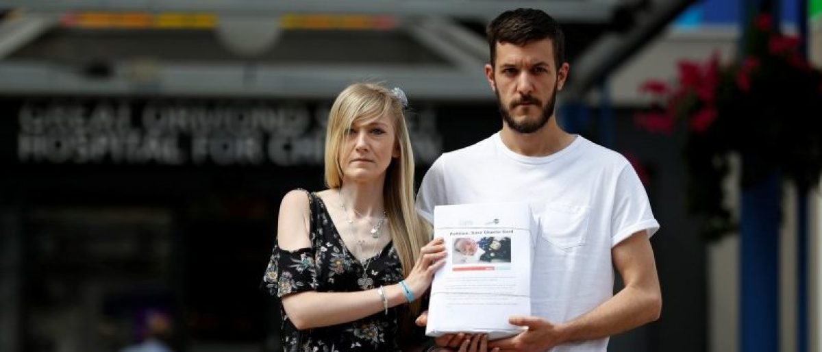 The parents of critically ill baby Charlie Gard, Connie Yates and Chris Gard, pose for the media with a petition, outside Great Ormond Street Hospital, in central London, Britain July 9, 2017. REUTERS/Peter Nicholls