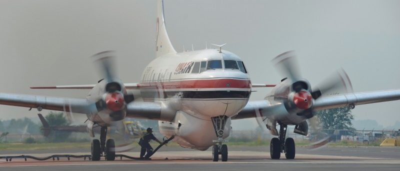 A ground crew fills a Conair airtanker with fire retardant at the Provincial Wildfire Coordination Centre at Kamloops Airport in Kamloops, British Columbia, Canada July 8, 2017. REUTERS/Dennis Owens