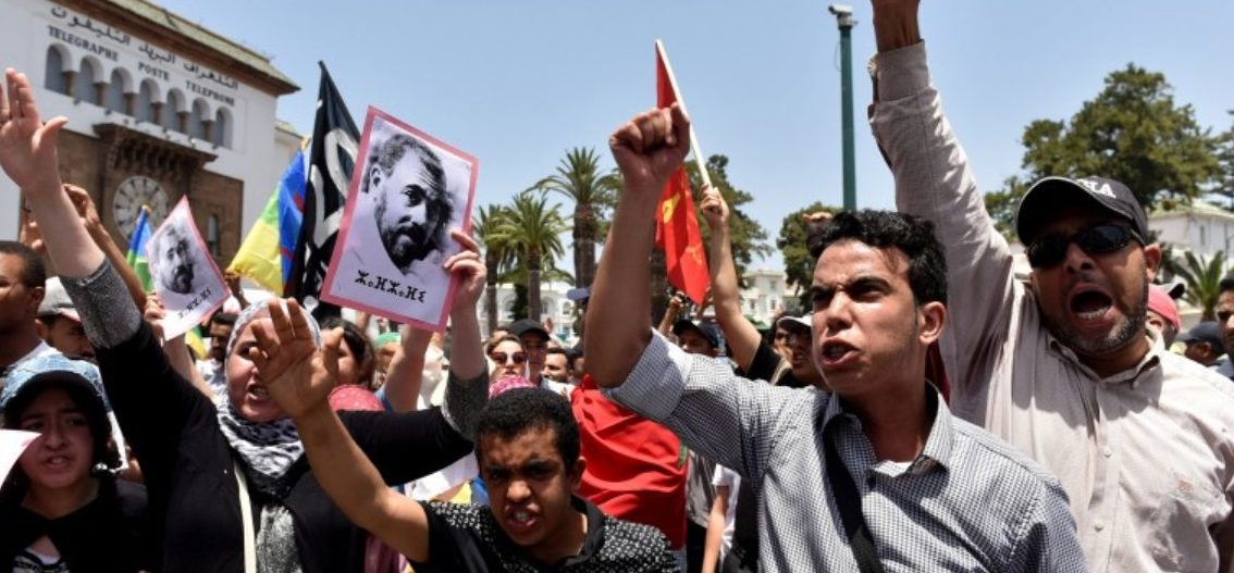 Protesters shout slogans during a demonstration against corruption and official abuses, in the Rif region in Rabat, Morocco June 11, 2017. On left is a portrait of protest movement leader Nasser Zefzafi. REUTERS/Stringer