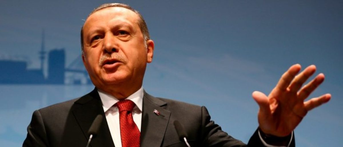 FILE PHOTO: Turkish President Recep Tayyip Erdogan speaks during a news conference in Hamburg, Germany July 8, 2017. REUTERS/Wolfgang Rattay