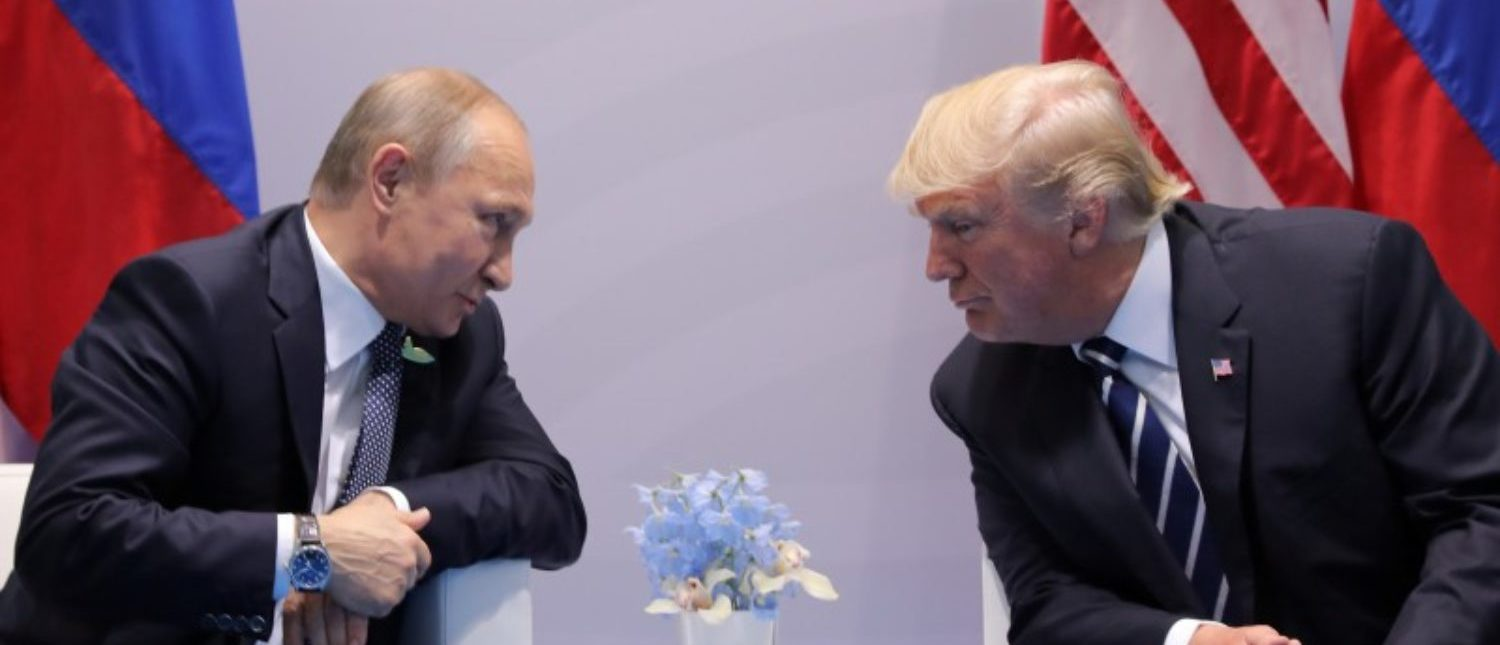 FILE PHOTO: Russia's President Vladimir Putin talks to U.S. President Donald Trump during their bilateral meeting at the G20 summit in Hamburg, Germany July 7, 2017. REUTERS/Carlos Barria