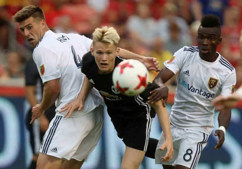 Soccer Football - Real Salt Lake vs Manchester United - Pre Season Friendly - Sandy, USA - July 17, 2017 Manchester United's Scott McTominay in action with Real Salt Lake's Sunday Stephen and David Horst (L) REUTERS/Jim Urquhart