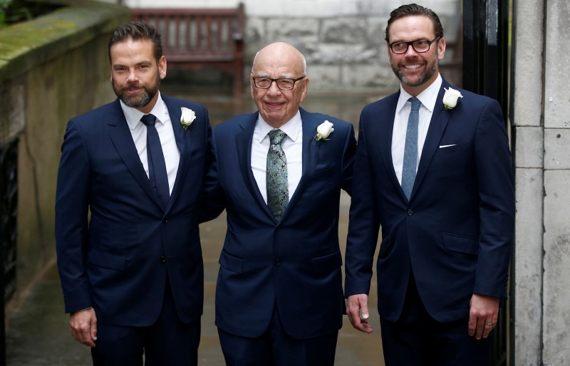 Media Mogul Rupert Murdoch (C) poses for a photograph with his sons Lachlan (L) and James in London, March 5, 2016. REUTERS/Peter Nicholls