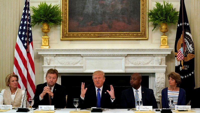 President Donald Trump speaks during a lunch meeting with Senate Republicans to discuss healthcare at the White House in Washington, July 19, 2017. From left are Senators Shelley Moore Capito (R-WV), Dean Heller (R-NV), Tim Scott (R-SC) and Lisa Murkowski (R-AK). REUTERS/Kevin Lamarque