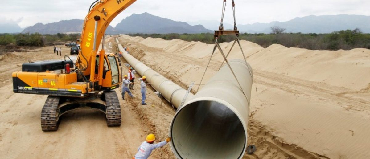 FILE PHOTO: Workers prepare a pipeline during the construction of the Olmos Irrigation Project in Lambayeque