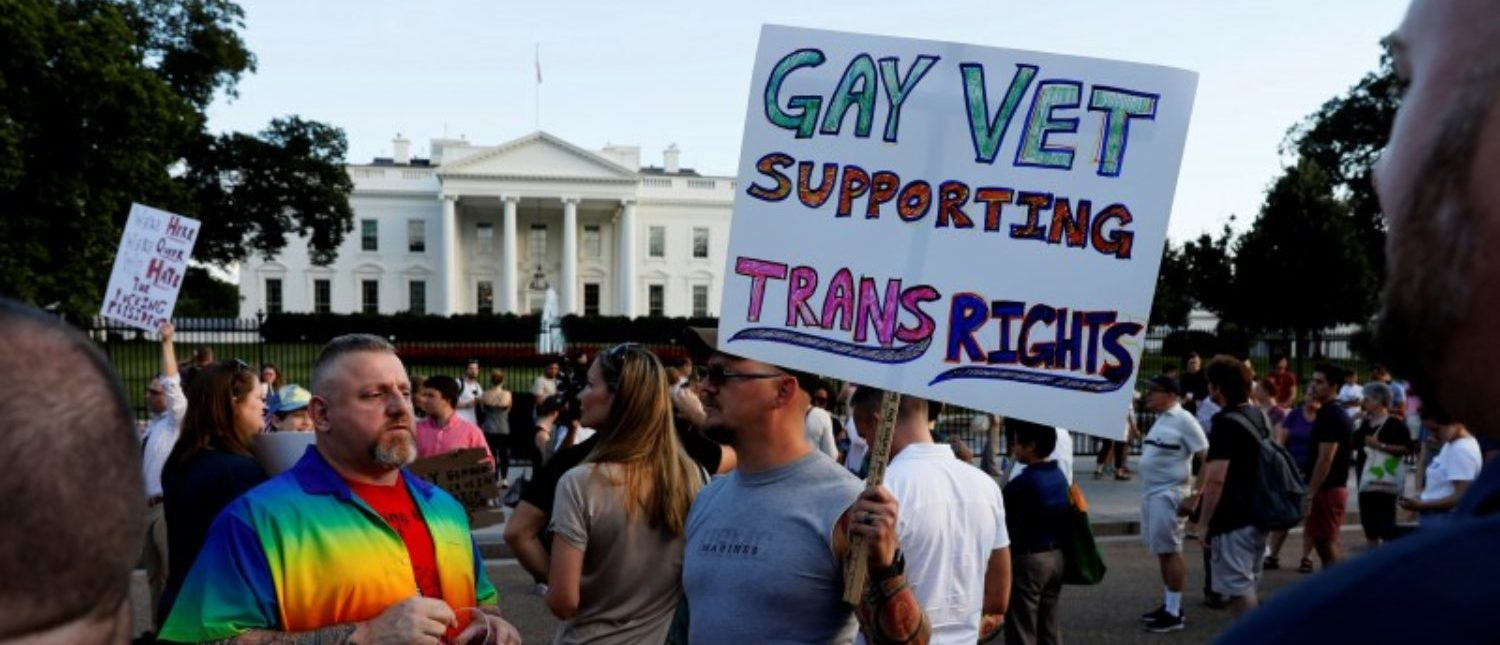 Demonstrators gather to protest U.S. President Donald Trump's announcement that he plans to reinstate a ban on transgender individuals from serving in any capacity in the U.S. military, at the White House in Washington, U.S. July 26, 2017. REUTERS/Jonathan Ernst
