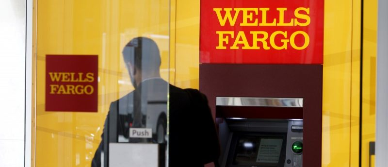 FILE PHOTO - A man walks by a bank machine at the Wells Fargo & Co. bank in downtown Denver, Colorado, U.S. on April 13, 2016.   REUTERS/Rick Wilking/File Photo