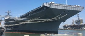 The aircraft carrier Pre-Commissioning Unit Gerald R. Ford (CVN 78) is docked at Pier 11 of Naval Station Norfolk, Virginia, June 30, 2017. The ship was undergoing preparations for commissioning July 22, 2017. The aircraft carrier USS George Washington (CVN 73) is at background right. (Department of Defense photo by Thomas M. Ruyle)