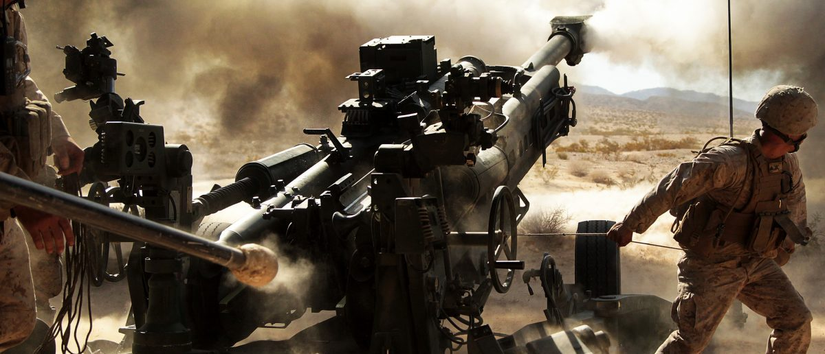 Marines with Battery N, 5th Battalion, 14th Marine Regiment, fire an M777 A2 howitzer during a series of integrated firing exercises at the Marine Corps Air Ground Combat Centter Twentynine Palms' Quakenbush Training Area April 26, 2013.