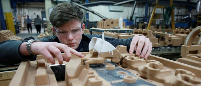 Apprentice Ryan Hickman works with a sand mould of a car engine ready for casting at GW cast in Bridgnorth, Britain, March 3, 2017. REUTERS/Andrew Yates