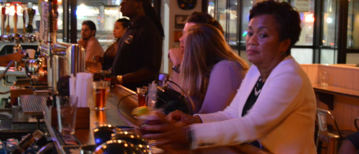 New Haven Mayor Toni Harp waits for a bartender to recognize her. (Photo: Davis Richardson/The Daily Caller)