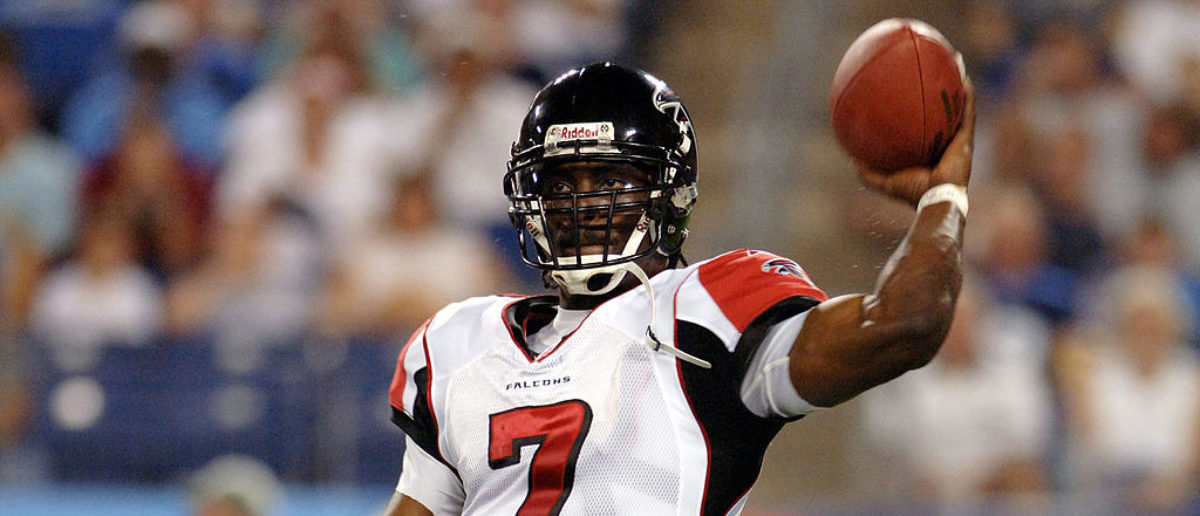 Falcons Michael Vick #7 throws during first half action between the Atlanta Falcons and the Tennessee Titans on August 26, 2006 at The Coliseum in Nashville, Tennessee. (Photo by Joe Murphy/NFLPhotoLibrary)