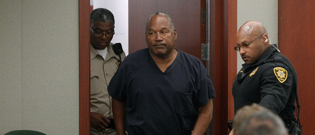 O.J. Simpson arrives at an evidentiary hearing in Clark County District Court May 16, 2013 in Las Vegas. (Photo by Steve Marcus-Pool/Getty Images)
