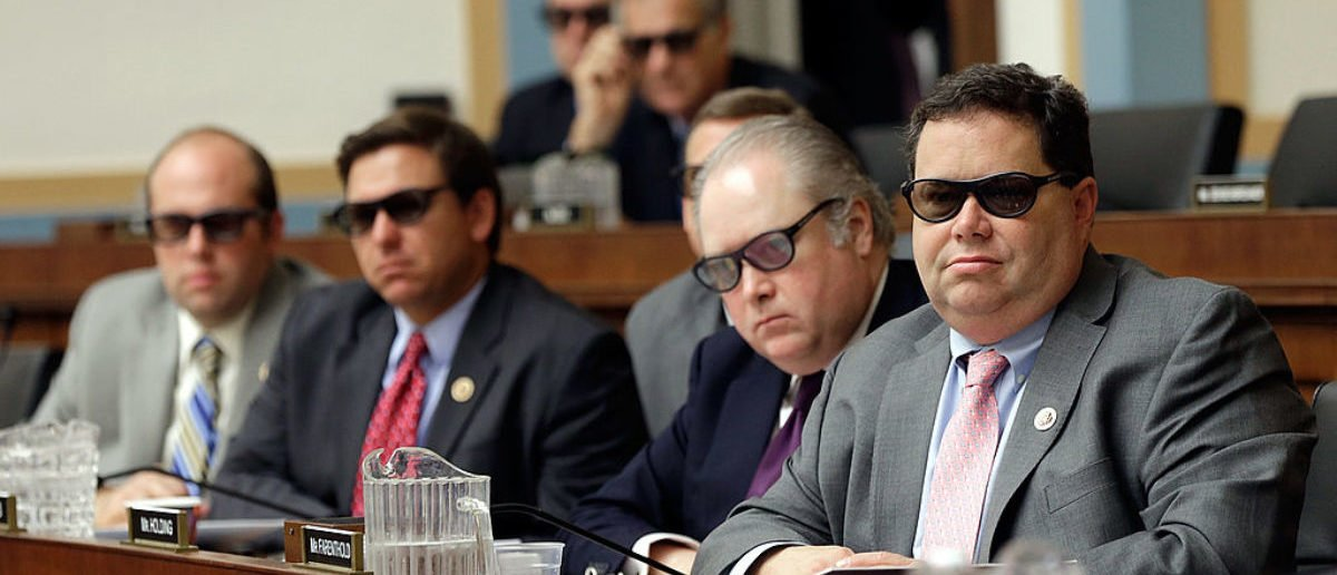 """WASHINGTON, DC - JULY 25: (R-L) Rep. Blake Farenthold (R-TX), Rep. George Holding (R-GA), Rep. Ron DeSantis (R-FL) and Rep. Jason Smith (R-MO), join othermembers of the House Courts, Intellectual Property and the Internet Subcommittee in wearing 3D glasses while watching a demonstration of 3D technology on Capitol Hill July 25, 2013 in Washington, DC. The subcommittee, a part of the House Judiciary Committee, heard testimony on the topic of """"Innovation in America: The Role of Copyrights."""" (Photo by Win McNamee/Getty Images)"""