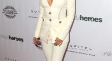 Selena rocks the white suit (Photo Credit: Getty Images)