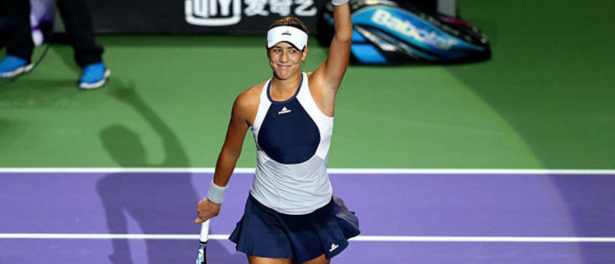 SINGAPORE - OCTOBER 30:  Garbine Muguruza of Spain waves to the crowd after defeating Petra Kvitova of Czech Republic in a round robin match during the BNP Paribas WTA Finals at Singapore Sports Hub on October 30, 2015 in Singapore.  (Photo by Clive Brunskill/Getty Images)