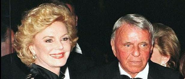LOS ANGELES, UNITED STATES: This 25 October 1996 file photo shows entertainer Frank Sinatra (R) and his wife Barbara as they arrive at the Carousel of Hope benefit in Beverly Hills, California. Sinatra died 14 May at the age of 82 in Los Angeles. AFP PHOTO (Photo credit should read STR/AFP/Getty Images)