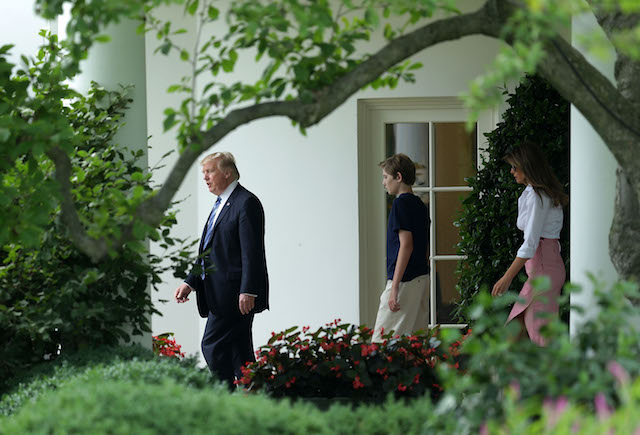 WASHINGTON, DC - JUNE 30: U.S. President Donald Trump comes out from the Oval Office with first lady Melania Trump and son Barron Trump prior to a South Lawn Marine One departure at the White House June 30, 2017 in Washington, DC. President Trump is spending the weekend with his family in Bedminster, New Jersey. (Photo by Alex Wong/Getty Images)