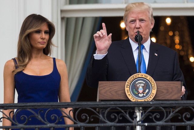 WASHINGTON, DC - JULY 4: U.S. President Donald Trump delivers remarks as first lady Melania Trump looks on from the Truman Balcony on July 4, 2017, in Washington, DC. The president was hosting a picnic for military families for the July 4 holiday. (Photo by Zach Gibson/Getty Images)