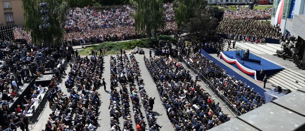 Guests listen as US President Donald Trump gives a speech on Krasinski Square during the Three Seas Initiative Summit in Warsaw, Poland, July 6, 2017. SAUL LOEB/AFP/Getty Images
