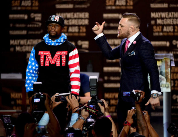 Floyd Mayweather Jr. and Conor McGregor faceoff on stage during the Floyd Mayweather Jr. v Conor McGregor World Press Tour at Staples Center on July 11, 2017 in Los Angeles, California. (Photo by Harry How/Getty Images)