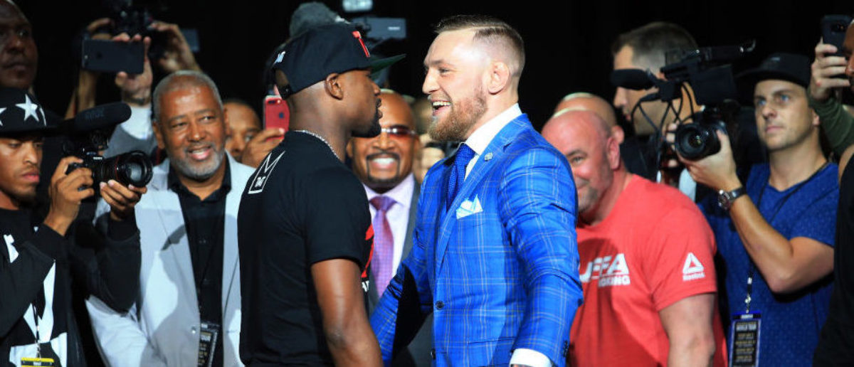 TORONTO, ON - JULY 12:  Floyd Mayweather Jr. and Conor McGregor faceoff during the Floyd Mayweather Jr. v Conor McGregor World Press Tour at Budweiser Stage on July 12, 2017 in Toronto, Canada.  (Photo by Vaughn Ridley/Getty Images)