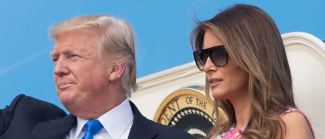 US President Donald Trump and First Lady Melania Trump walk to Air Force One prior to departure from Andrews Air Force Base in Maryland, July 25, 2017, as they travel to Ohio  for a campaign rally. / AFP PHOTO / SAUL LOEB        (Photo credit should read SAUL LOEB/AFP/Getty Images)