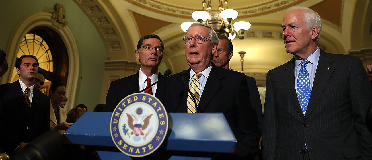 U.S. Sen. John Barrasso (R-WY), Senate Majority Leader Mitch McConnell (R-KY), U.S. Sen. John Thune (R-SD) and U.S. Sen. John Cornyn (R-TX) speak to reporters during a news conference on Capitol Hill following a procedural vote on the GOP health care bill on July 25, 2017 in Washington, DC. U.S. Vice President Mike Pence cast the tying vote on a procedural vote to move forward on the GOP health care bill. (Photo by Justin Sullivan/Getty Images)